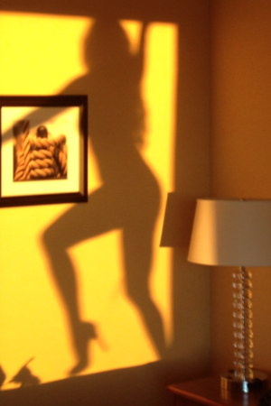 shadow of a woman on a wall